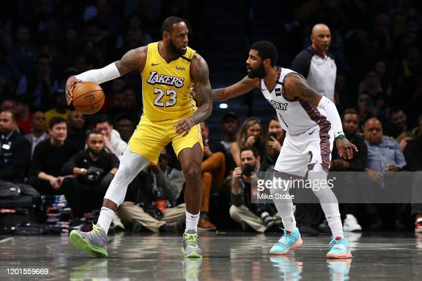 LeBron James of the Los Angeles Lakers posts up against Kyrie Irving of the Brooklyn Nets at Barclays Center on January 23, 2020 in New York City....