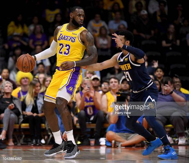LeBron James of the Los Angeles Lakers posts up Jamal Murray of the Denver Nuggets during a preseason game at Valley View Casino Center on September...