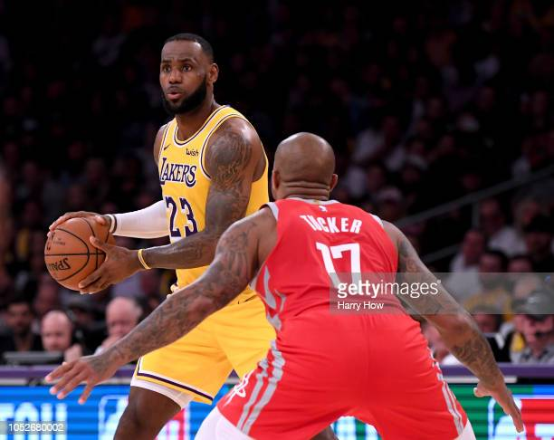 LeBron James of the Los Angeles Lakers prepares to pass as he is guarded by PJ Tucker of the Houston Rockets during a 124115 Rockets win at Staples...