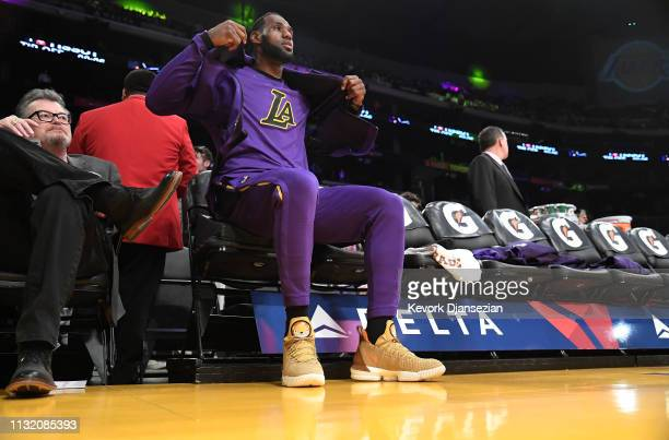 LeBron James of the Los Angeles Lakers puts on his jacket prior to the start of a basketball game against Brooklyn Nets at Staples Center on March 22...