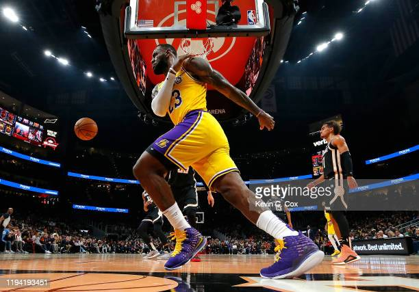 LeBron James of the Los Angeles Lakers reacts after a dunk against the Atlanta Hawks in the first half at State Farm Arena on December 15 2019 in...
