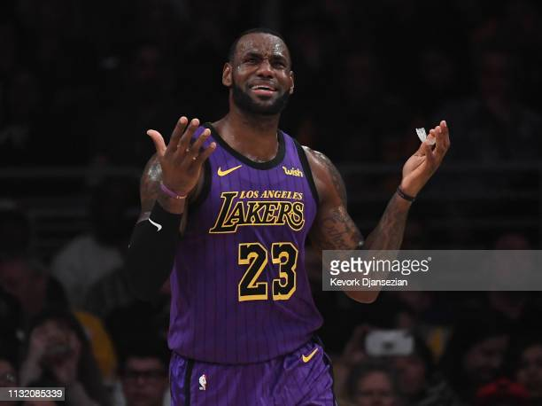 LeBron James of the Los Angeles Lakers reacts after a foul call against him during the first half of the basketball game against Brooklyn Nets at...