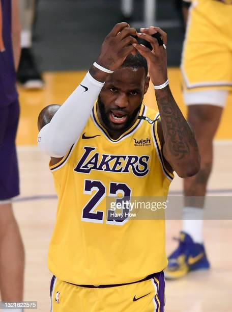 LeBron James of the Los Angeles Lakers reacts after a Phoenix Suns foul in the second quarter during game six of the Western Conference first round...