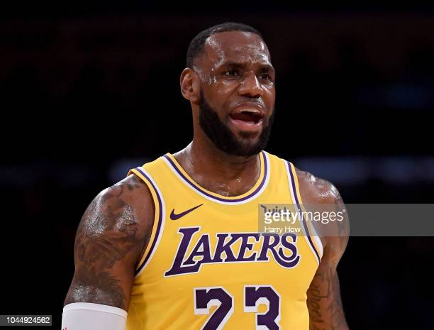 LeBron James of the Los Angeles Lakers reacts after a play at the end of the second quarter during a preseason game against the Denver Nuggets at...