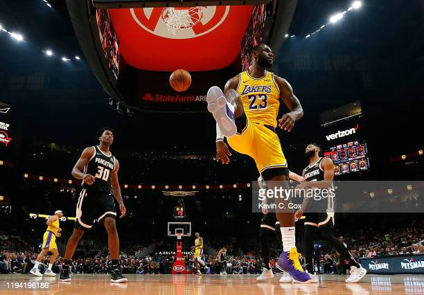 LeBron James of the Los Angeles Lakers reacts after dunking against the Atlanta Hawks in the first half at State Farm Arena on December 15 2019 in...