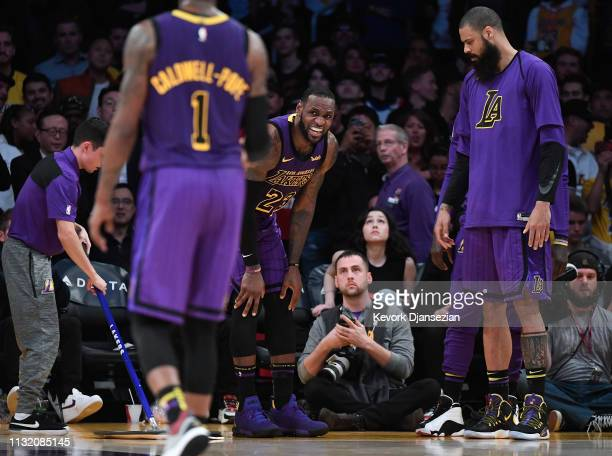 LeBron James of the Los Angeles Lakers reacts after falling during the second half against Brooklyn Nets during the basketball game at Staples Center...