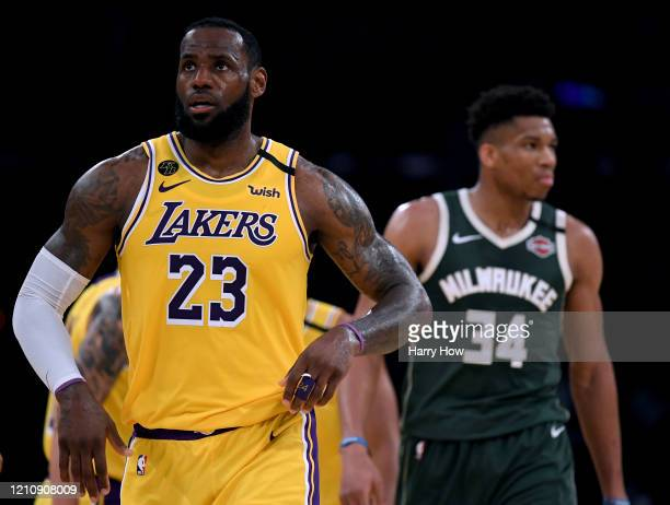 LeBron James of the Los Angeles Lakers reacts after his basket in front of Giannis Antetokounmpo of the Milwaukee Bucks at Staples Center on March 06...
