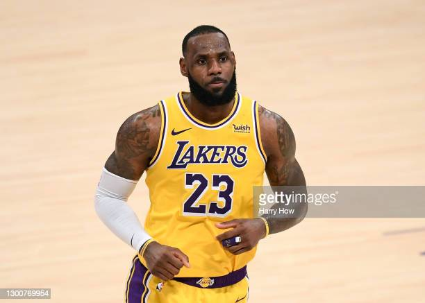 LeBron James of the Los Angeles Lakers reacts after his three pointer in double overtime to lead the Lakers to a 135-129 win over the Detroit...