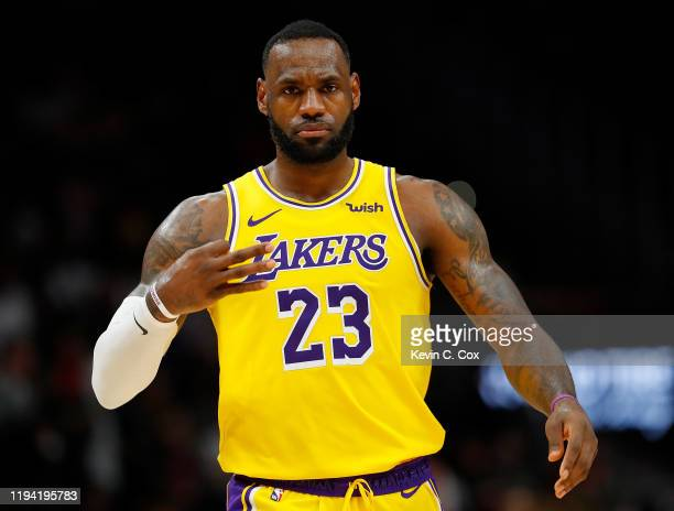 LeBron James of the Los Angeles Lakers reacts after hitting a three-point basket against the Atlanta Hawks in the second half at State Farm Arena on...