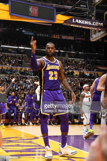 LeBron James of the Los Angeles Lakers reacts after passing Michael Jordan on the NBA AllTime Scoring Leaders List against the Denver Nuggets on...
