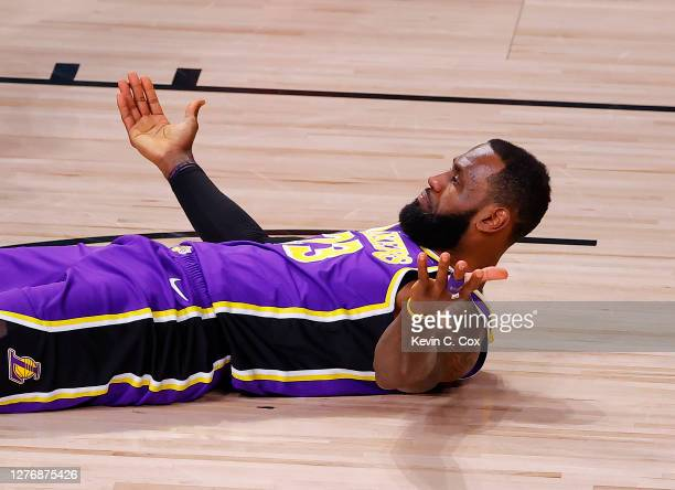 LeBron James of the Los Angeles Lakers reacts after taking an offensive foul during the first quarter against the Denver Nuggets in Game Five of the...
