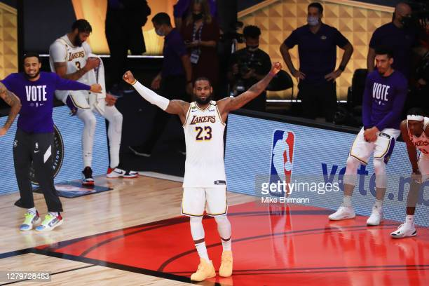 LeBron James of the Los Angeles Lakers reacts after winning the 2020 NBA Championship over the Miami Heat in Game Six of the 2020 NBA Finals at...