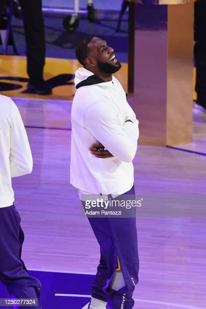 LeBron James of the Los Angeles Lakers reacts as he gets his 2019-20 NBA Championship ring during the ring ceremony before the game against the LA...