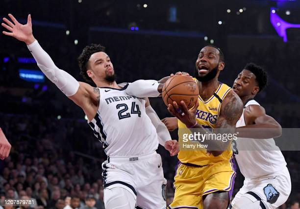 LeBron James of the Los Angeles Lakers reacts as he splits the defense of Dillon Brooks and Jaren Jackson Jr #13 of the Memphis Grizzlies during the...