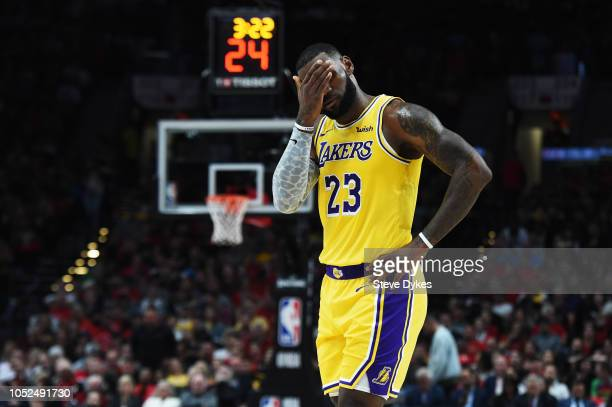 LeBron James of the Los Angeles Lakers reacts in the first quarter against the Portland Trail Blazers during their game at Moda Center on October 18...