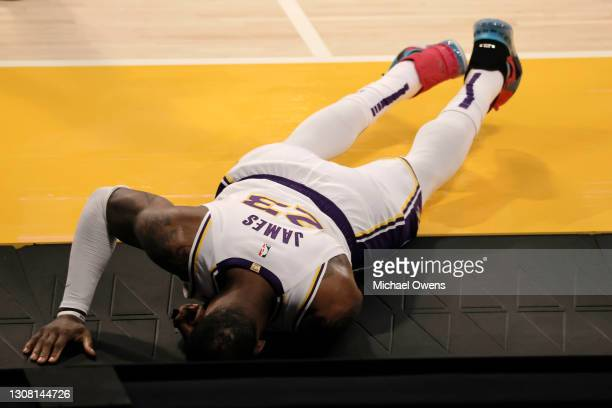 LeBron James of the Los Angeles Lakers reacts to an apparent injury during the second period of a game against the Atlanta Hawks at Staples Center on...