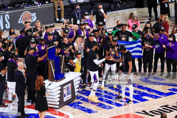 LeBron James of the Los Angeles Lakers reacts with Anthony Davis of the Los Angeles Lakers after winning the 2020 NBA Championship over the Miami...