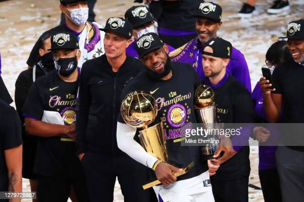 LeBron James of the Los Angeles Lakers reacts with his MVP trophy and Finals trophy after winning the 2020 NBA Championship over the Miami Heat in...