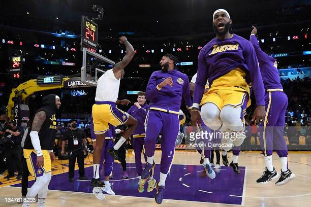 LeBron James of the Los Angeles Lakers reacts with his teammates as they are introduced prior to the game against the Golden State Warriors at...
