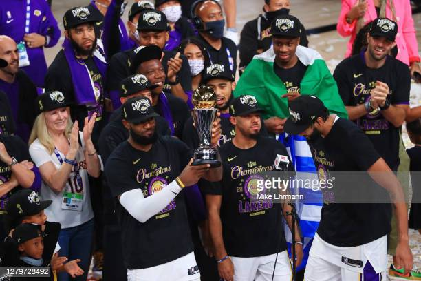 LeBron James of the Los Angeles Lakers reacts with the trophy after winning the 2020 NBA Championship over the Miami Heat in Game Six of the 2020 NBA...