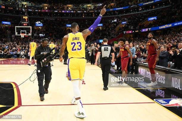 LeBron James of the Los Angeles Lakers recognizes the fans after the Cleveland Cavaliers honored James during a timeout during the first half at...