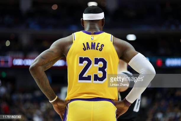 LeBron James of the Los Angeles Lakers rects during a preseason game as part of 2019 NBA Global Games China at Mercedes-Benz Arena on October 10,...