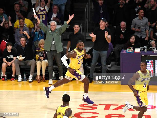 LeBron James of the Los Angeles Lakers runs after a slam dunk against the Houston Rockets at Staples Center on October 20 2018 in Los Angeles...