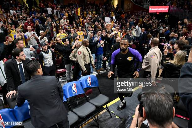 LeBron James of the Los Angeles Lakers runs on to the court prior to the game against the Cleveland Cavaliers at Quicken Loans Arena on November 21...