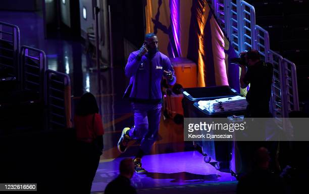 LeBron James of the Los Angeles Lakers runs out of the tunnel towards the basketball court during pre-game warm-ups before the start of a basketball...