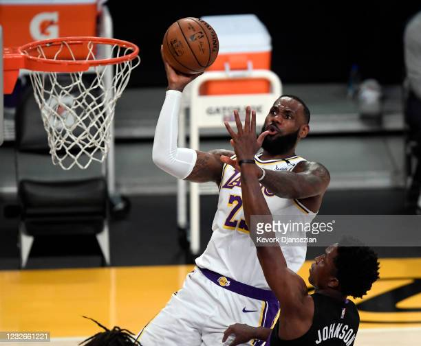 LeBron James of the Los Angeles Lakers scores a basket against Stanley Johnson of the Toronto Raptors during the first half at Staples Center on May...
