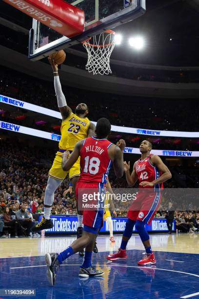 LeBron James of the Los Angeles Lakers scores a basket against Shake Milton and Al Horford of the Philadelphia 76ers in the third quarter at the...
