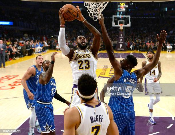 LeBron James of the Los Angeles Lakers scores a basket and gets fouled by Mo Bamba of the Orlando Magic during the first half at Staples Center on...