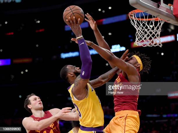 LeBron James of the Los Angeles Lakers scores as he is fouled by Myles Turner of the Indiana Pacers in front of Bojan Bogdanovic during a 10496 Laker...