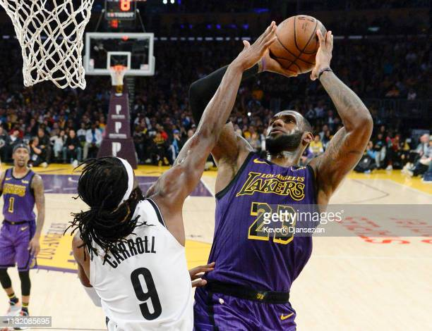 LeBron James of the Los Angeles Lakers scores basket against DeMarre Carroll of the Brooklyn Nets during the second half at Staples Center on March...