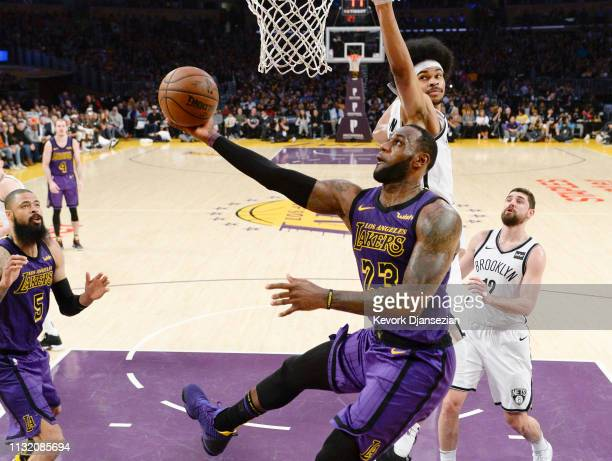 LeBron James of the Los Angeles Lakers scores basket against Jarrett Allen of the Brooklyn Nets during the second half at Staples Center on March 22...