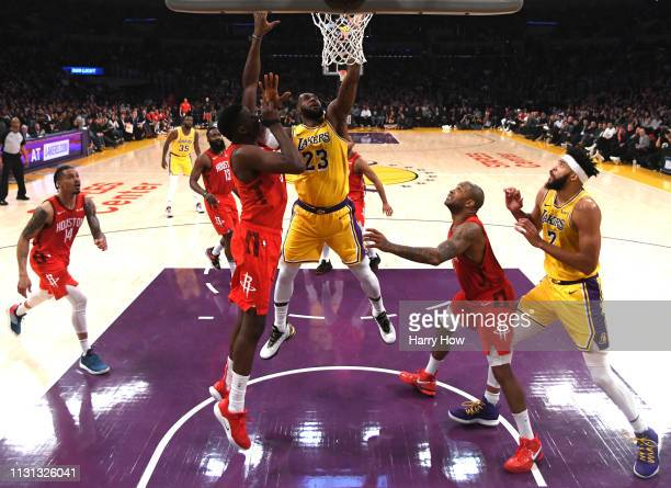 LeBron James of the Los Angeles Lakers scores in front of Clint Capela of the Houston Rockets as JaVale McGee and PJ Tucker look on during a 111106...