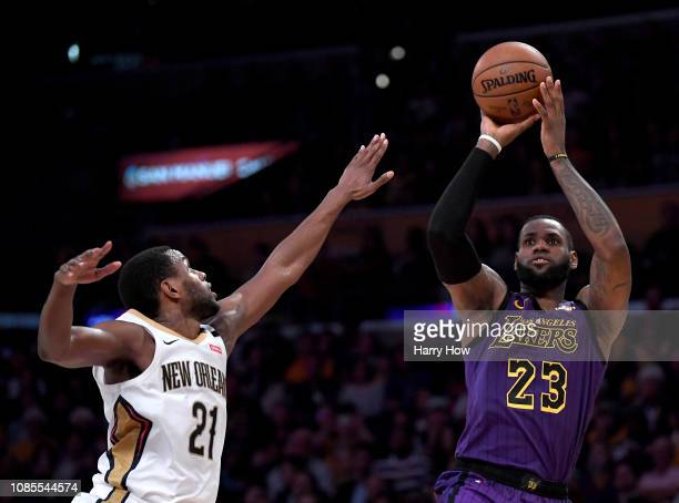 LeBron James of the Los Angeles Lakers scores on a fade away jumper over Darius Miller of the New Orleans Pelicans during a 112104 Laker win at...