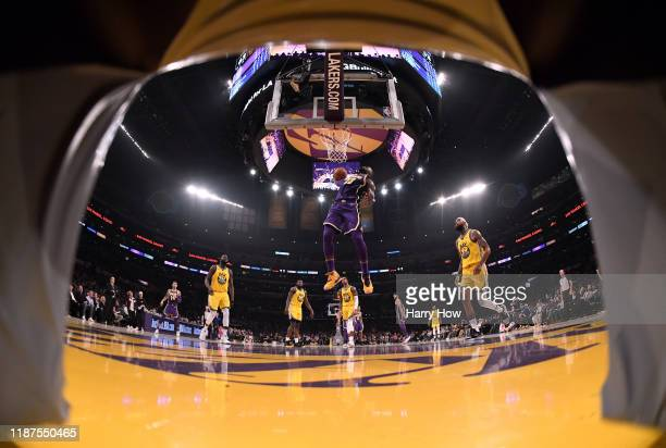 LeBron James of the Los Angeles Lakers scores sets up for a dunk behind the Golden State Warriors defense during a 12094 Lakers win at Staples Center...