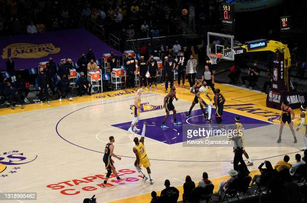 LeBron James of the Los Angeles Lakers scores the game winning three point basket against Stephen Curry of the Golden State Warriors in the closing...