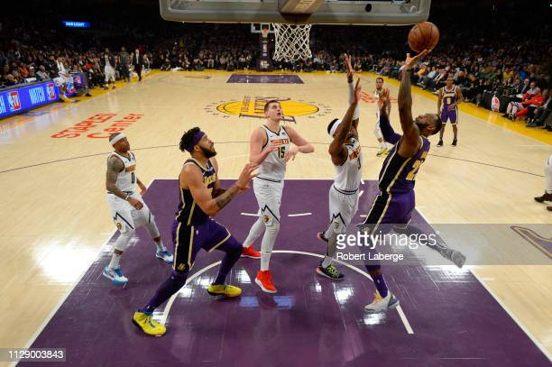 LeBron James of the Los Angeles Lakers scores to pass Michael Jordan and move to on the NBA's alltime scoring list during the second quarter against...