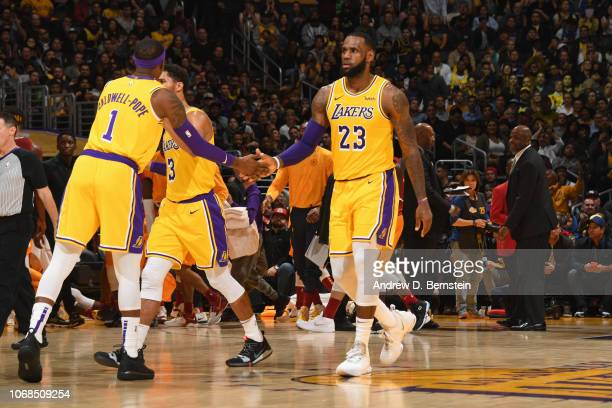 LeBron James of the Los Angeles Lakers shakes hand with Kentavious CaldwellPope of the Los Angeles Lakers during the game against the Indiana Pacers...
