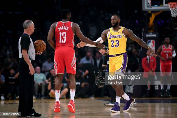 LeBron James of the Los Angeles Lakers shakes hands with James Harden of the Houston Rockets before the home season opening game at Staples Center on...