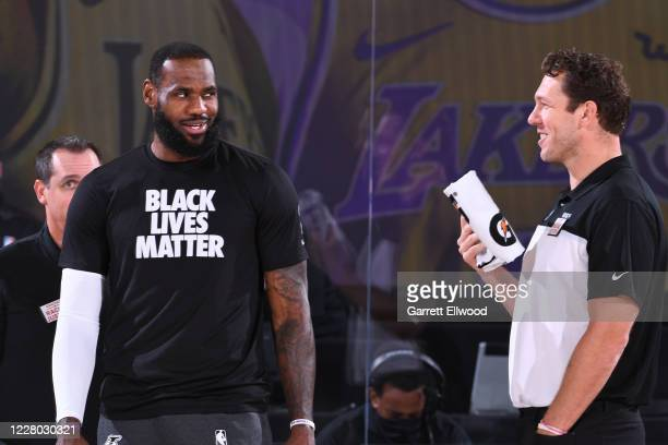 LeBron James of the Los Angeles Lakers shares a laugh with head coach Luke Walton of the Sacramento Kings before the game on August 13 2020 at The...