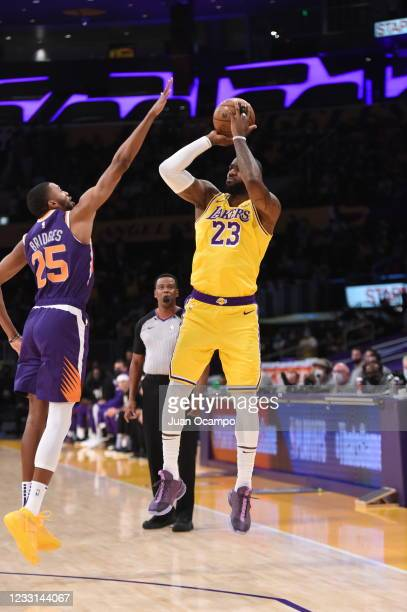 LeBron James of the Los Angeles Lakers shoots a 3-pointer against the Phoenix Suns during Round 1, Game 3 of the 2021 NBA Playoffs on May 27, 2021 at...