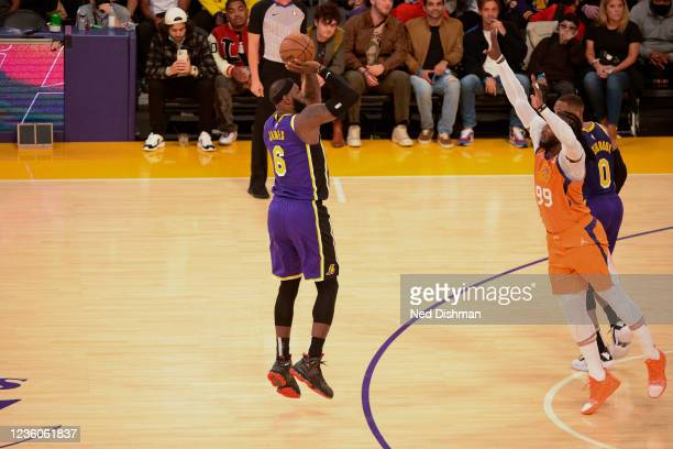 LeBron James of the Los Angeles Lakers shoots a three point basket against the Phoenix Suns on October 22, 2021 at STAPLES Center in Los Angeles,...