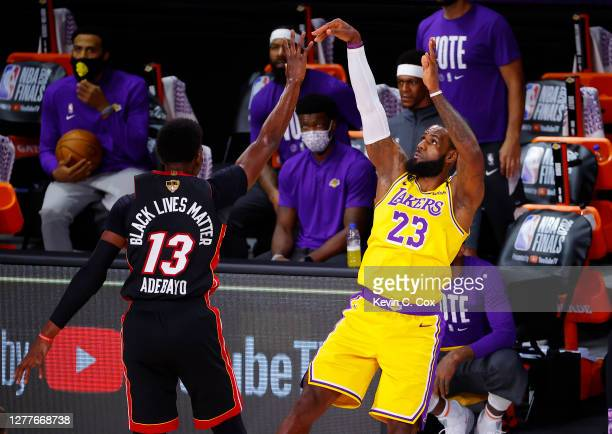 LeBron James of the Los Angeles Lakers shoots a three point basket against the Miami Heat during the first quarter in Game One of the 2020 NBA Finals...