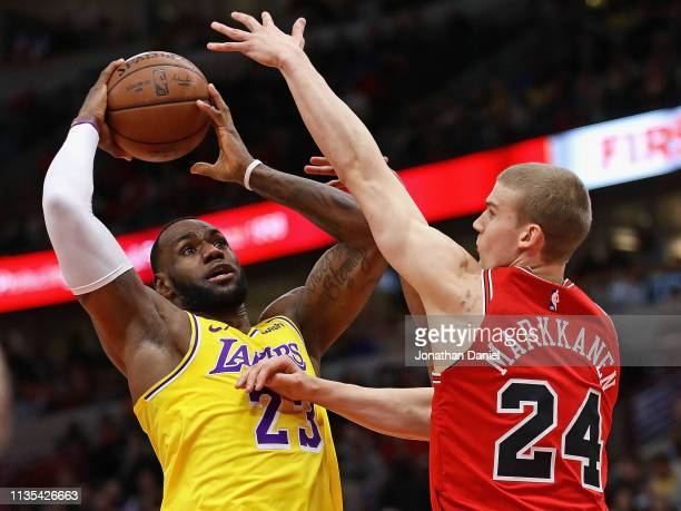 LeBron James of the Los Angeles Lakers shoots against Lauri Markkanen of the Chicago Bulls at the United Center on March 12 2019 in Chicago Illinois...
