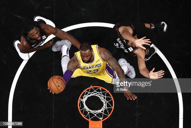 LeBron James of the Los Angeles Lakers shoots against Spencer Dinwiddie and Jarrett Allen of the Brooklyn Nets during their game at the Barclays...