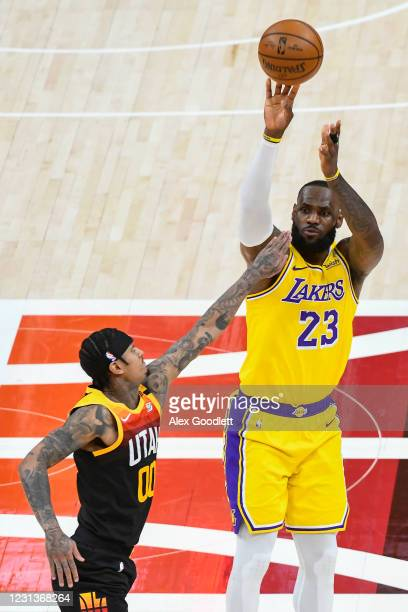 LeBron James of the Los Angeles Lakers shoots over Jordan Clarkson of the Utah Jazz during a game at Vivint Smart Home Arena on February 24, 2021 in...