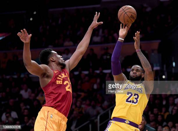 LeBron James of the Los Angeles Lakers shoots over Thaddeus Young of the Indiana Pacers during a 10496 Laker win at Staples Center on November 29...